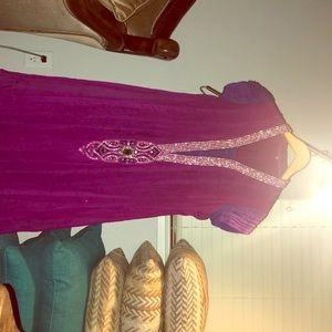 It's a purple dress with nice nick line design.